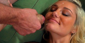 Foxy blonde coed plays with a stiff prick and gets facialized