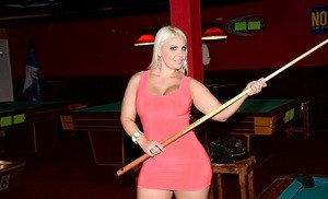 Curvaceous blonde MILF reveaaling her goods and posing on the pool table