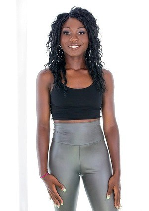 Ebony sugar in silver leggings undressing and exposing her ass