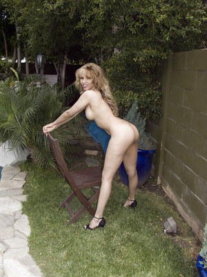 Frisky MILF getting nude and showcasing her goods outdoor