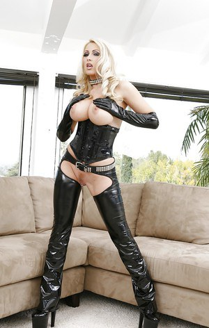 Steamy blonde in fetish latex outfit demonstrating her boobs and pussy