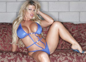 Curvaceous blonde MILF slipping off her tiny bikini and spreading her legs