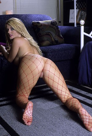 Curvy vixen in fishnet pantyhose strips down and makes some foot fetish action