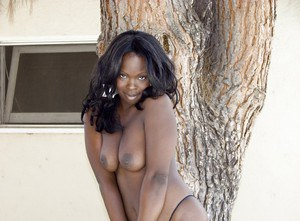 Hot ebony slut strips off her panties to play with her cunt