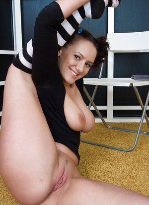 Sassy floosie in striped socks revealing her big melons and toying her gash
