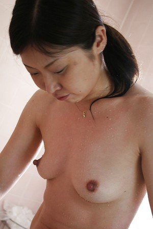 Lusty asian MILF with hard nipples taking shower and rubbing her body