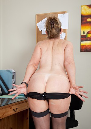 Lusty mature office lady revealing her big melons and inviting twat
