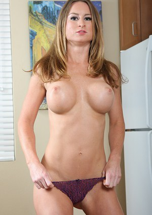 Horny MILf babe with big tits plays with her pussy in the kitchen naked