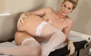 Naughty mature nurse in white  stockings undressing and teasing her gash