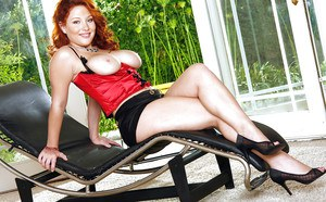 Busty redhead pornstar takes off her red lingerie to play with herself
