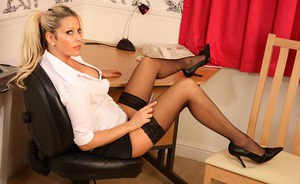 Sassy mature office vixen in nylons reveals her jugs and inviting cunt