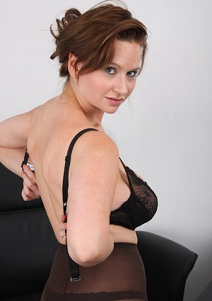 Slutty MILF with huge boobs gets naughty in the office and strips naked