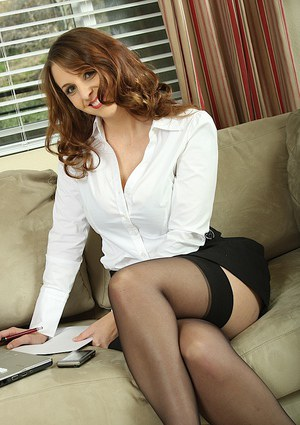 MILF babe takes off her uniform in the office to play with her pussy