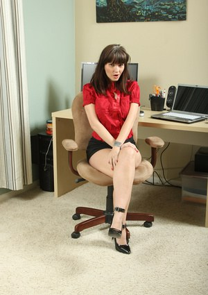 Busty office MILF undressing and toying her pierced gash with a glass dildo