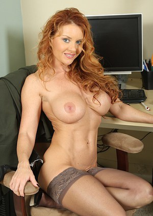 Curly-haired redhead office lady in nylons undressing and exposing her gash