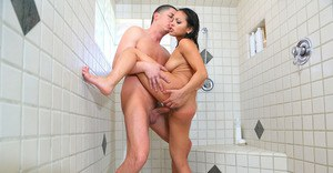 Steamy latina vixen with big tits enjoys tough twatting in the shower