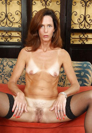 Mature skinny babe spreading her legs to feel her hairy cunt