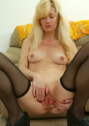 Lusty mature maid in stockings undressing and spreading her cunt