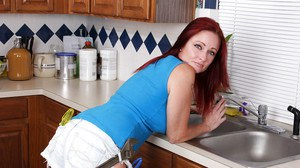 Curvy redhead mature vixen undressing and teasing herself with water jets