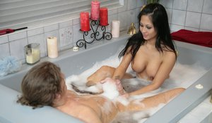 Asian slut gives soapy tit and handjob pleasure in the foamy bath