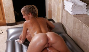 Perky masseuse gives some soapy cock teasing treatment to her client
