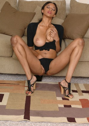 Saucy ebony amateur with huge melons undressing and teasing her honey pot