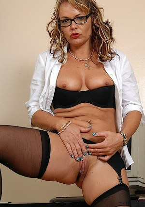 Mature office slut in glasses gets naked to masturbate her twat
