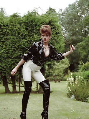 Tempting fetish lady posing in sexy horse jokey outfit outdoor