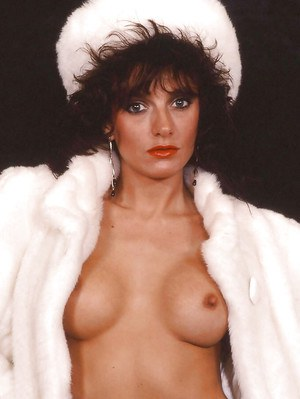 Fetish chick in black nylons flashing her tits in this vintage photo set