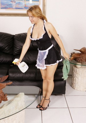 Sassy MILF in sexy maid uniform stripping and caressing herself
