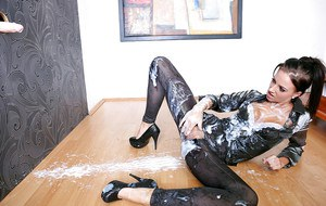 Lusty fetish chick has some messy fully clothed fun with a fake cock and jizz
