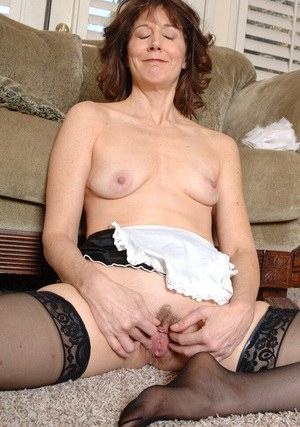 Lusty mature maid exposing her nylon clad feet and hairy pussy