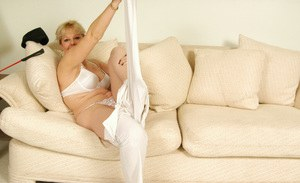 Naughty mature blonde stripping down and exposing her fuckable curves