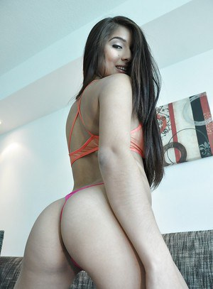 Amazingly sexy latina posing in sheer lingerie and flashing her gash