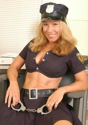 Lustful mature gal in sexy police uniform and thigh boots revealing her goods