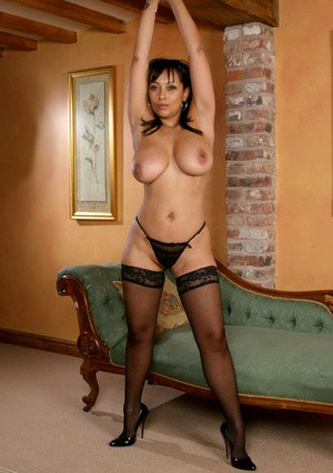 Sassy MILF in stockings uncovering her immensely tempting curves