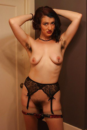 Sassy MILF with pierced nipples and hairy cunt slipping off her lingerie