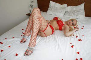 Gorgeous MILF undressing and taking on sexy red lingerie and fisnets