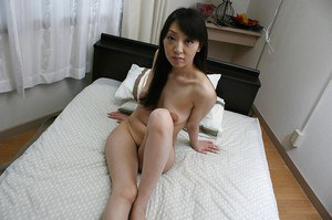Naked asian chick demonstrating her shaggy honey pot in close up