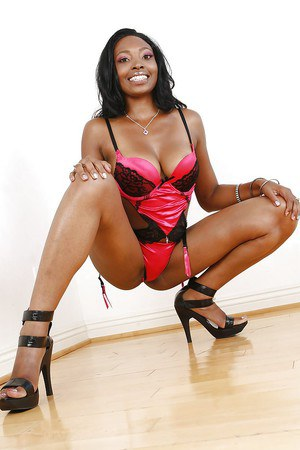 Smiley ebony MILF taking off her sexy lingerie and exposing her goods