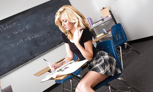 Lustful schoolgirl gets fucked and glazed with jizz up against the chalkboard