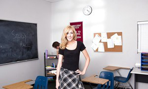 Cuddly blonde schoolgirl undressing and exposing her goods in the classroom