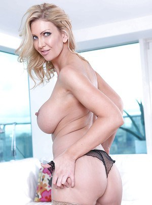 Frisky MILF in stockings revealing her huge tits and inviting pussy