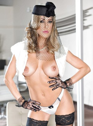 Glamorous MILF in gloves and stockings undressing and teasing her slit