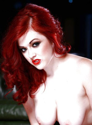 Curvy redhead temptress in snazzy stockings getting rid of her clothes
