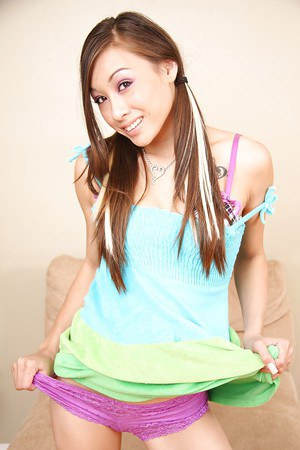 Skinny asian teen with pierced belly button undressing and spreading her vag