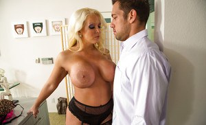 Sultry MILF with huge enhanced jugs gives a titjob and gets fucked tough