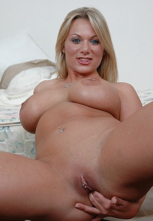 Playful blonde with pierced nipples undressing and spreading her slit