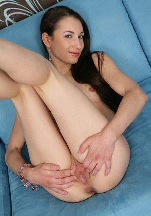 Smiley amateur with shaved cunt undressing and spreading her long legs