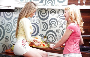 Horny teen lesbians have some pussy licking and fingering fun in the kitchen